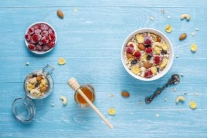 Healthy breakfast. fresh granola, muesli with nuts and frozen berries. top view. copy space. Free Photo